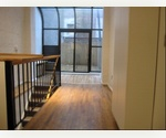 Amazing! 3 Bed Room Duplex With Hardwood Floors and Glass Atrium!